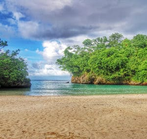 Frenchman's Cove Beach Port Antonio Jamaica see the sandy beaches with it's beautiful greenery making this a stunning visual for all those that visit.
